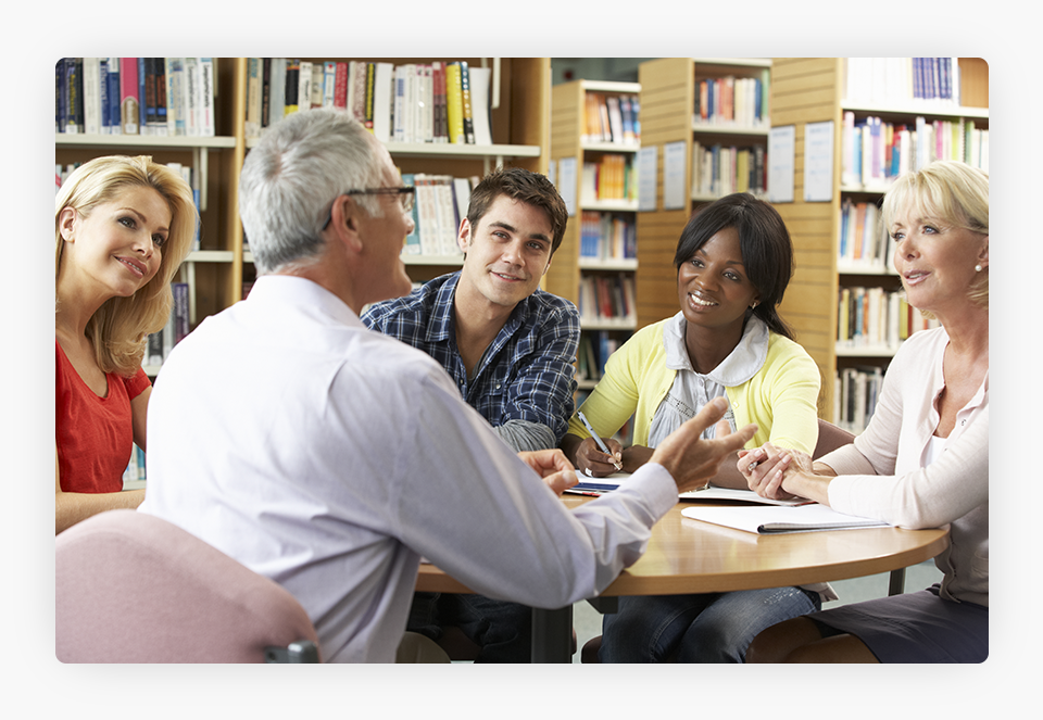 Group of People Around Table in Library